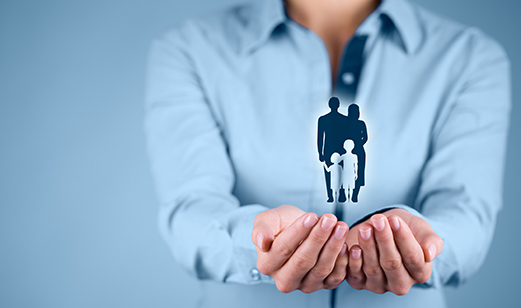 Family life insurance, family services, family policy and supporting families concepts. Businesswoman with protective gesture and silhouette representing young family.